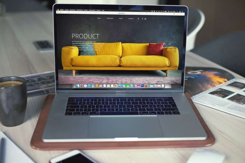 apple mac laptop with a website showing a product
