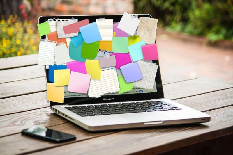 colourful post it notes stuck to laptop screen