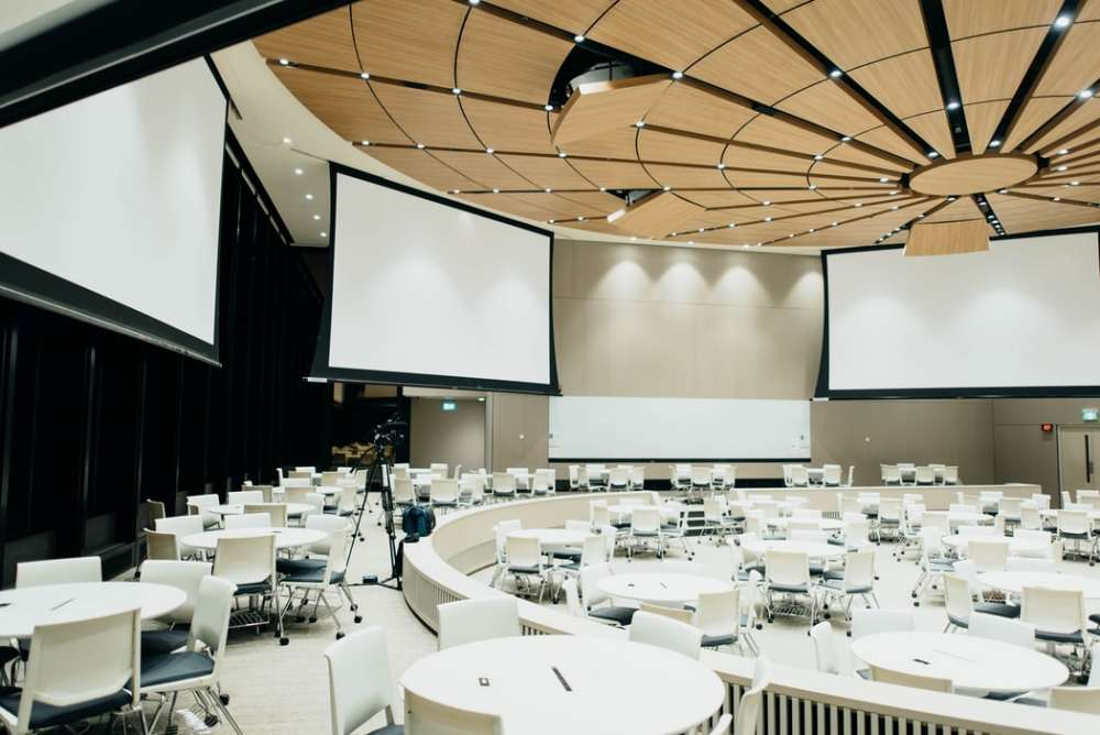 image of a conference room with projector screens