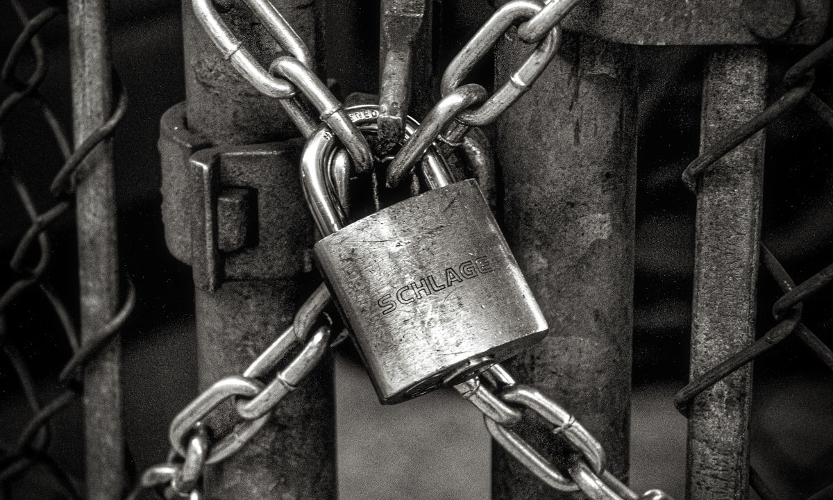 padlock image on a gate, representing security