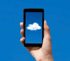 holding a smartphone cloud app